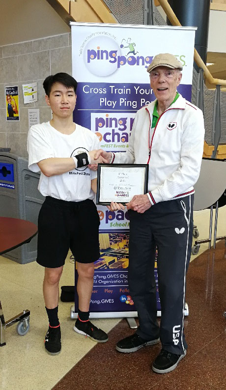 Dean Johnson is with Mitchell Zhou winner of the 4th Annual TowneBank Battle of the Paddles School and Scholarship Ping Pong Tournament on Saturday. Tournament was hosted by the Table Tennis Charity Foundation and held at Floyd E. Kellam High School in Virginia Beach.